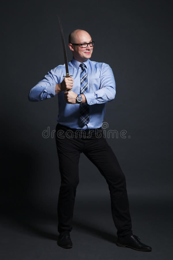 Businessman holding katana sword stock photo
