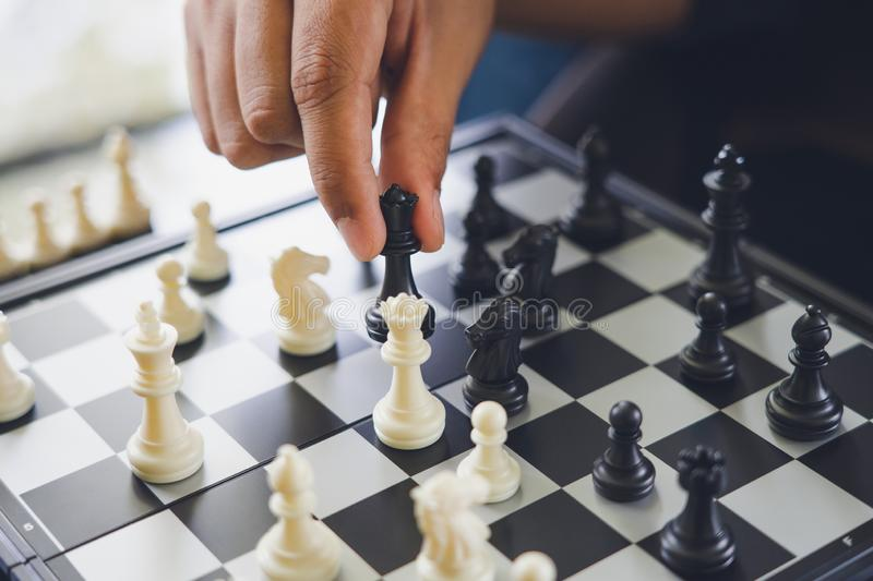 Businessman holding a King Chess is placed on a chessboard.using as background business concept and Strategy concept with copy royalty free stock photos