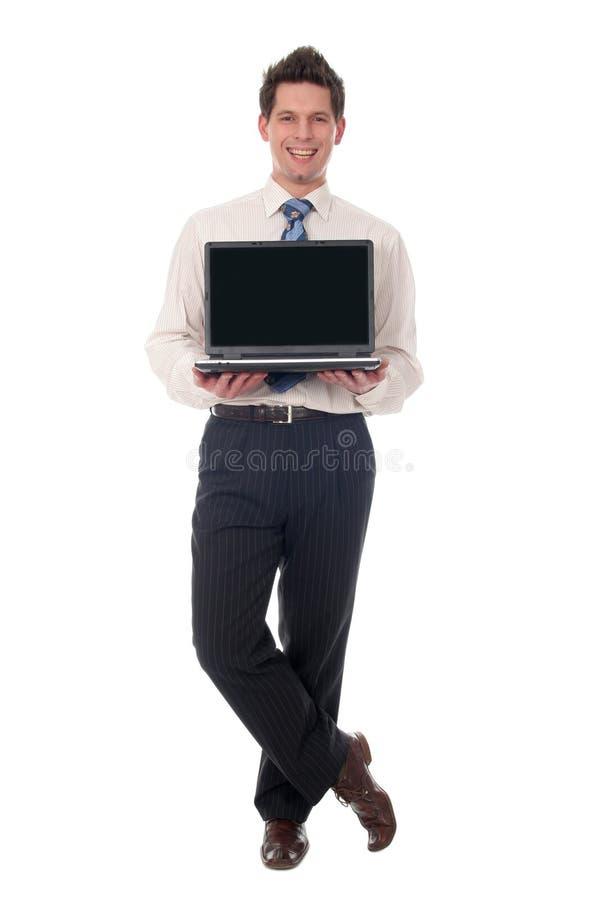 Businessman holding laptop stock photos