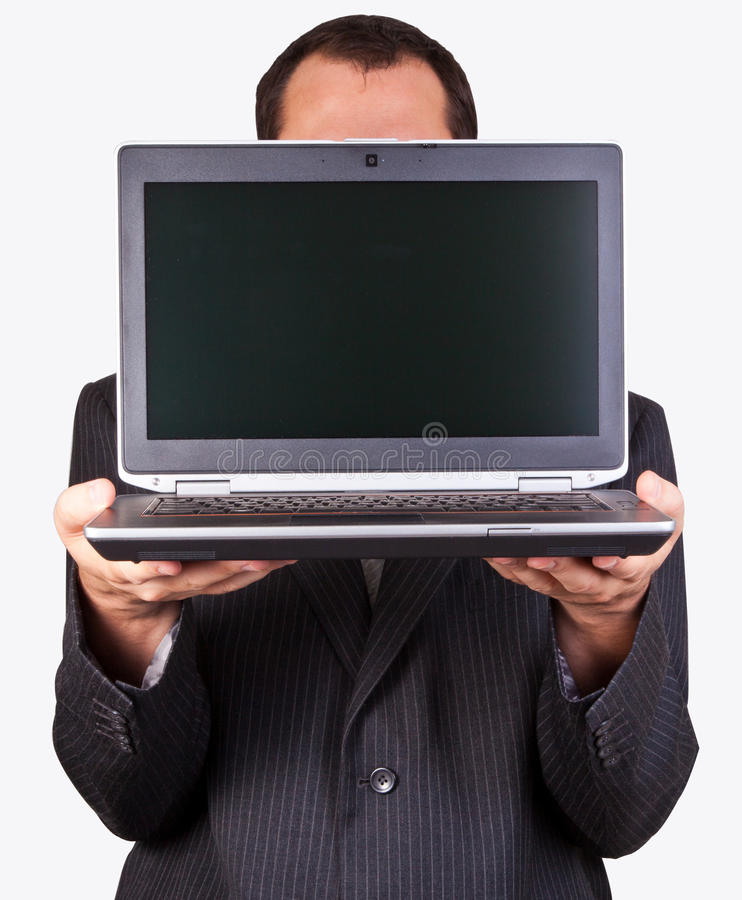 Businessman holding a laptop royalty free stock photos