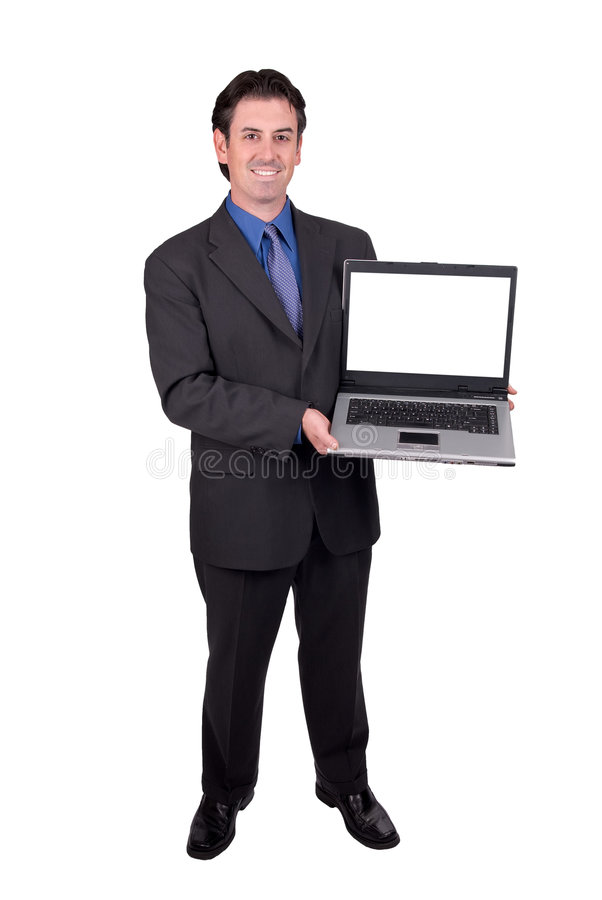Businessman holding a laptop. Businessman holding his laptop isolated over white royalty free stock images