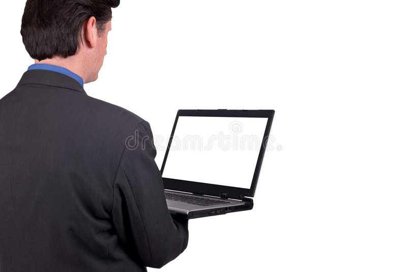 Businessman holding a laptop royalty free stock image