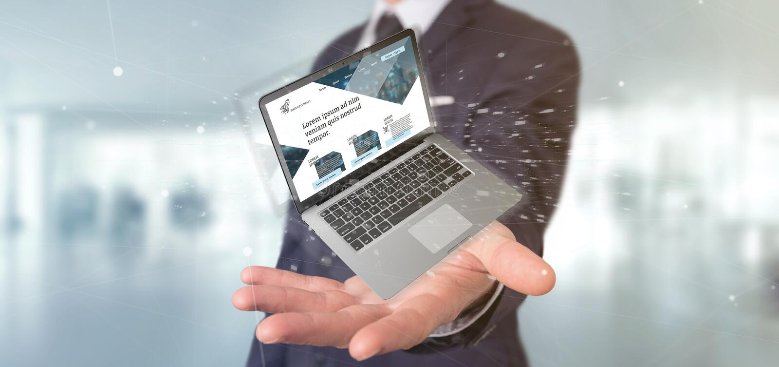 Businessman holding a Laptop with business website template on the screen isolated on a background stock photo