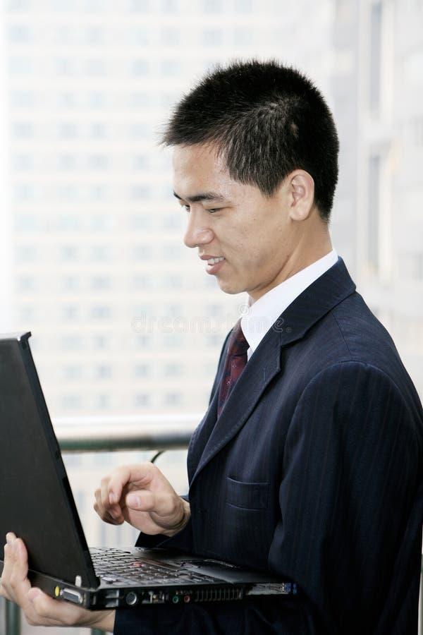 Download Businessman Holding Laptop Computer Stock Photo - Image: 6842578