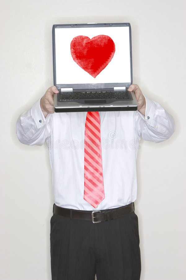 Businessman Holding Laptop with heart royalty free stock photo