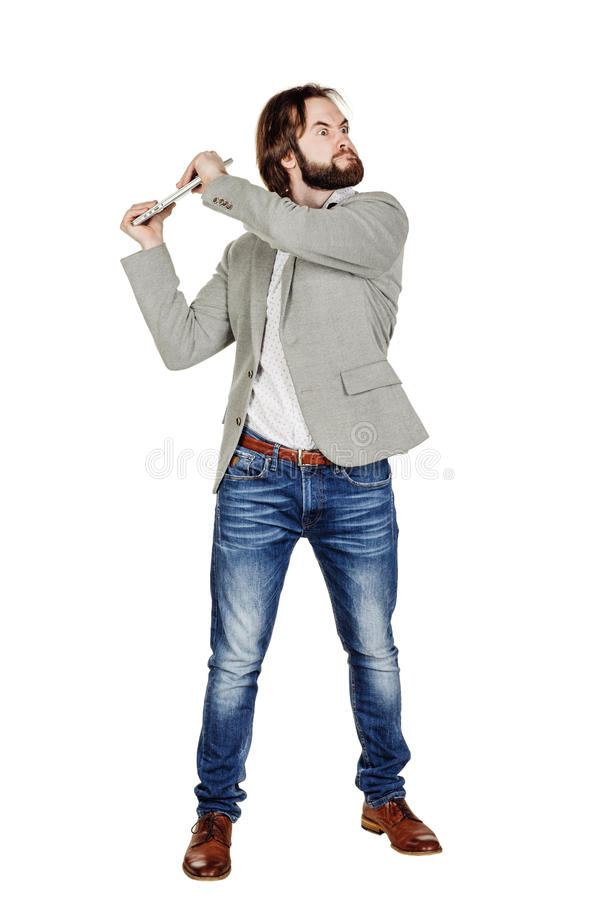 Businessman holding a laptop overhead and screaming stock image