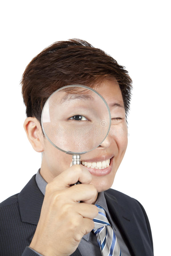 Businessman holding magnifier royalty free stock photos