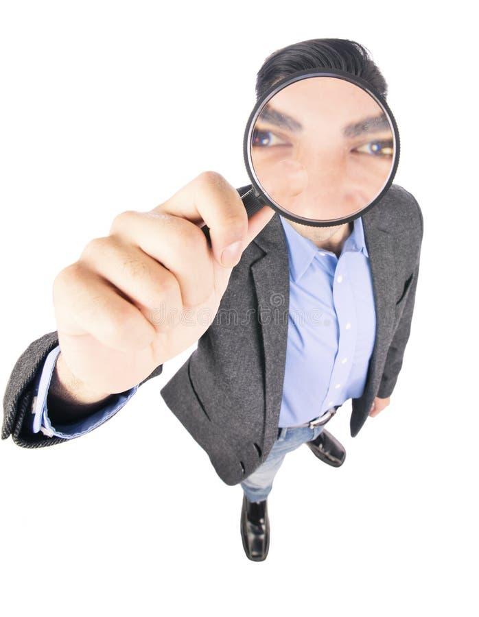 Businessman holding magnify glass. Hispanic businessman holding magnify glass isolated on withe background stock photos
