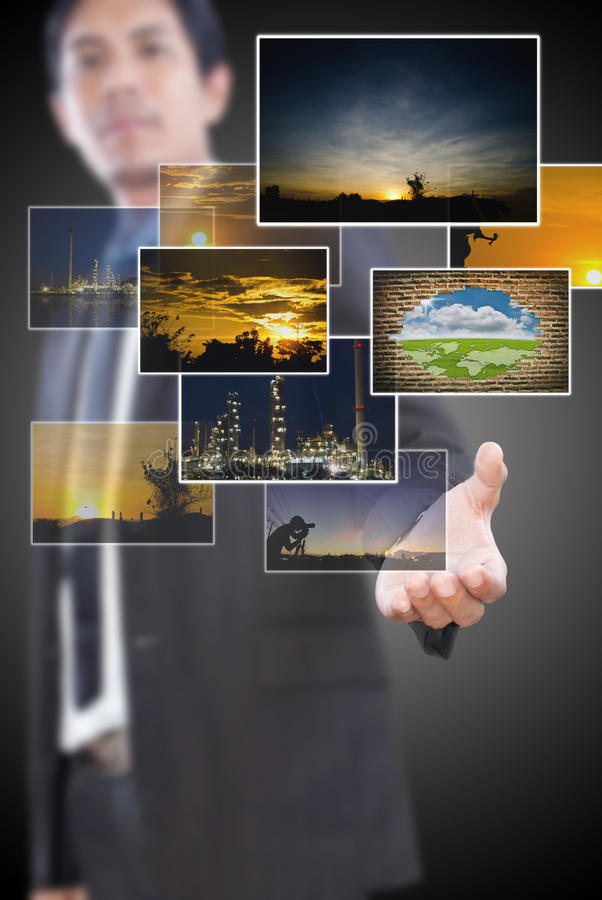 Free Businessman Holding Many Image Button. Royalty Free Stock Image - 24005536