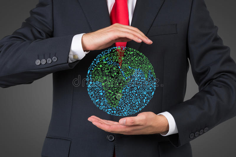 Businessman holding media icon in form earth stock photos