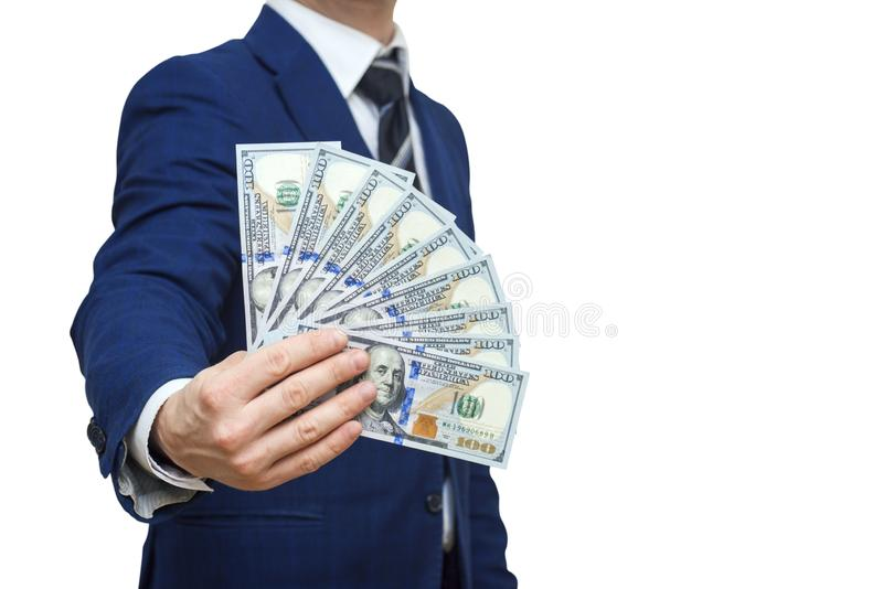 Businessman holding Money Cash Dollars in hands of passing them to the client. Businessman giving money, united states dollar stock images