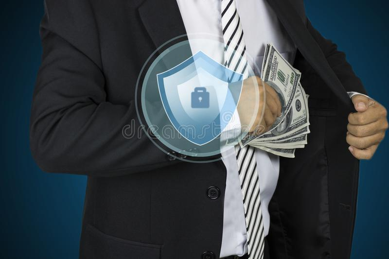 Businessman holding money from pocket with protection and save. Concept stock photography