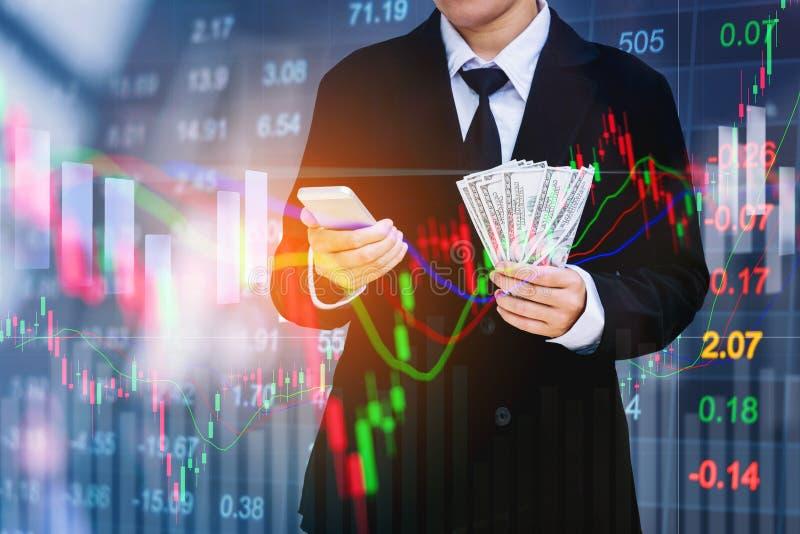 Businessman Holding money US dollar bills on digital stock market financial exchange information and Trading graph background.  stock images