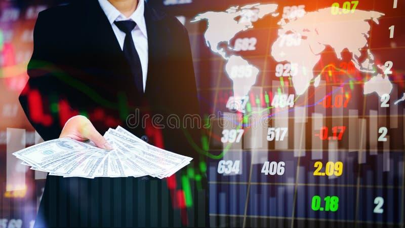 Businessman Holding money US dollar bills on digital stock market financial exchange information and Trading graph background.  stock photo