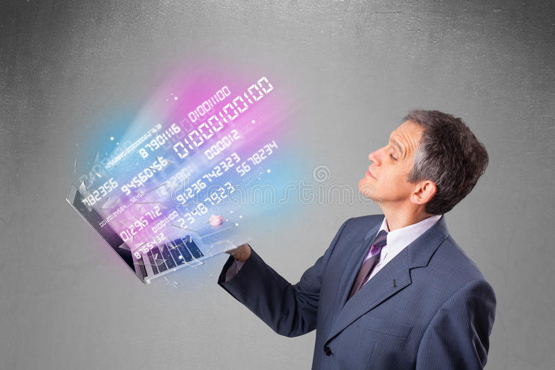 Businessman holding notebook with exploding data and numbers. Attractive businessman holding notebook with exploding data and numbers stock images