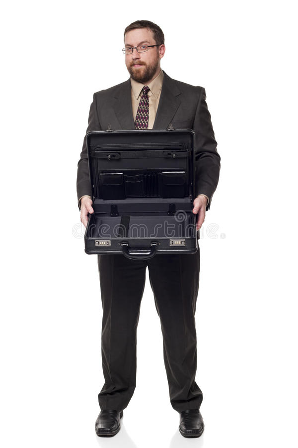 Businessman holding open briefcase showing. Isolated full length studio shot of the front view of a businessman holding an open briefcase and showing its stock photography