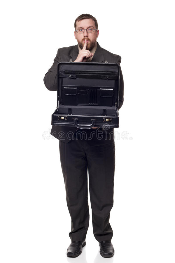 Businessman holding open briefcase showing. Isolated full length studio shot of the front view of a businessman holding an open briefcase and showing its royalty free stock images