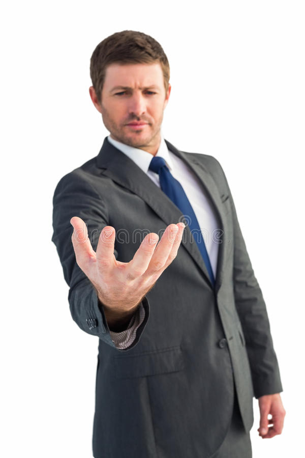 Businessman holding out his hand royalty free stock photography