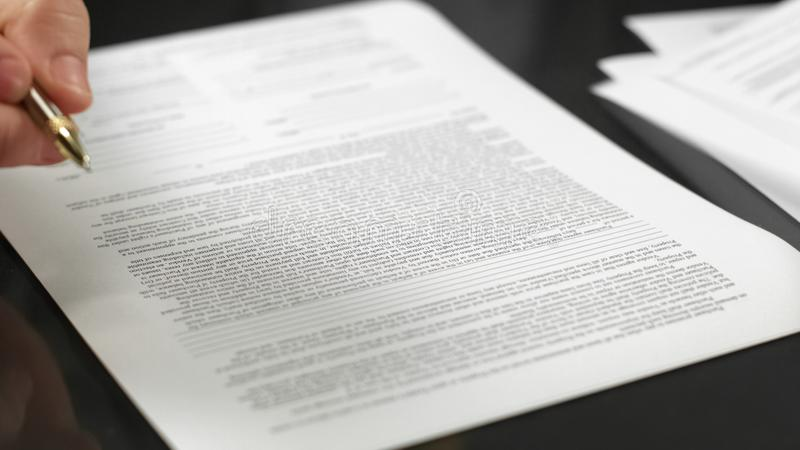 Businessman holding pen signing agreement, making deal, real estate rent, credit. Stock photo stock image