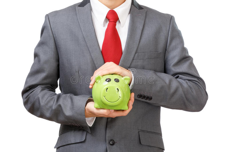 Businessman holding piggy bank. Isolated on white background. Detail of body without head stock image