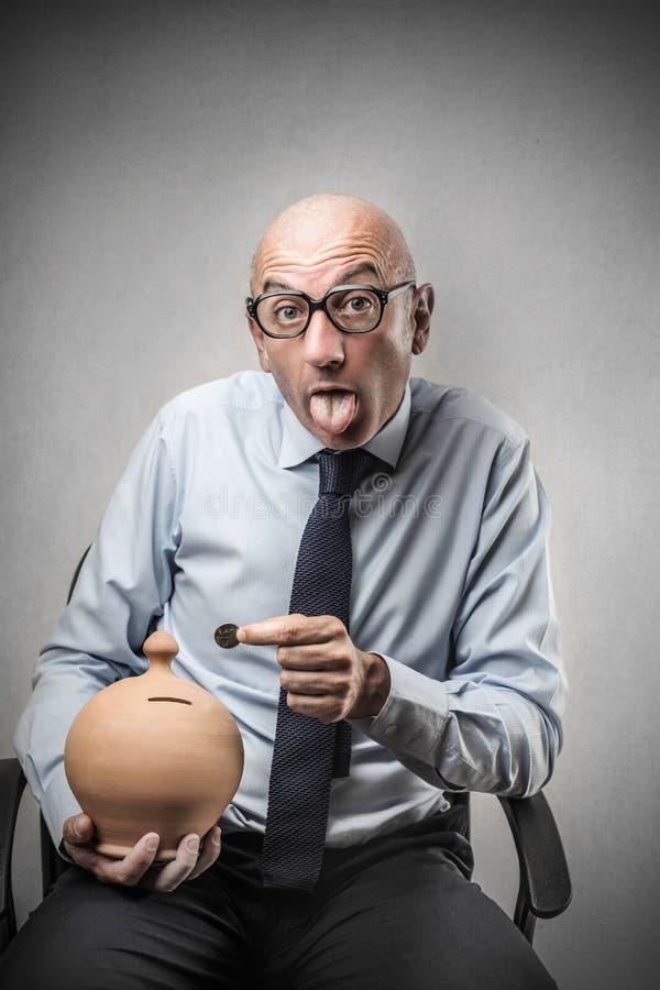Download Businessman Holding A Piggy-bank Stock Photo - Image of career, grimace: 39515466