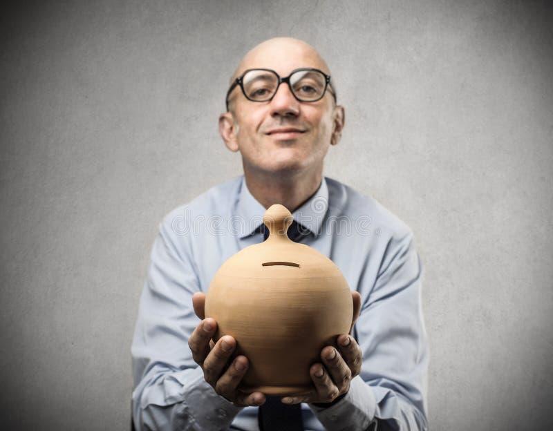 Download Businessman Holding A Piggy-bank Stock Image - Image of grimace, adult: 39515661