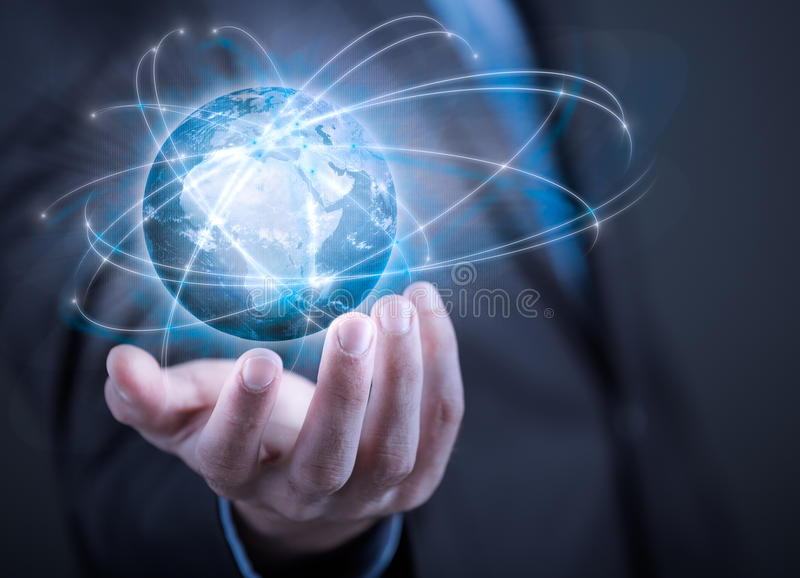 Businessman holding planet Earth in palm. Elements of this image are furnished by NASA stock image