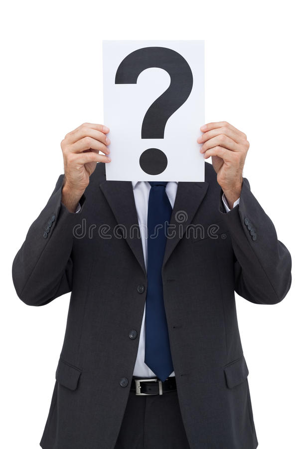 Businessman Holding A Question Mark Paper Stock Photo