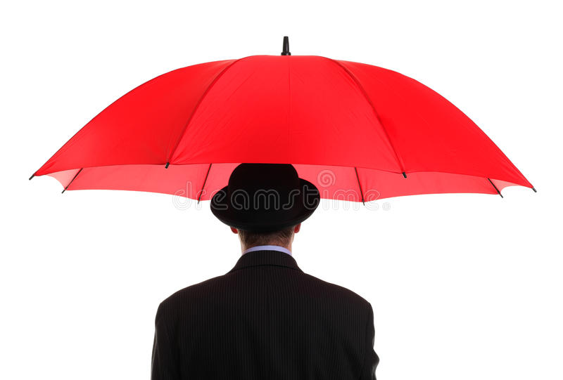 Businessman holding a red umbrella royalty free stock photography