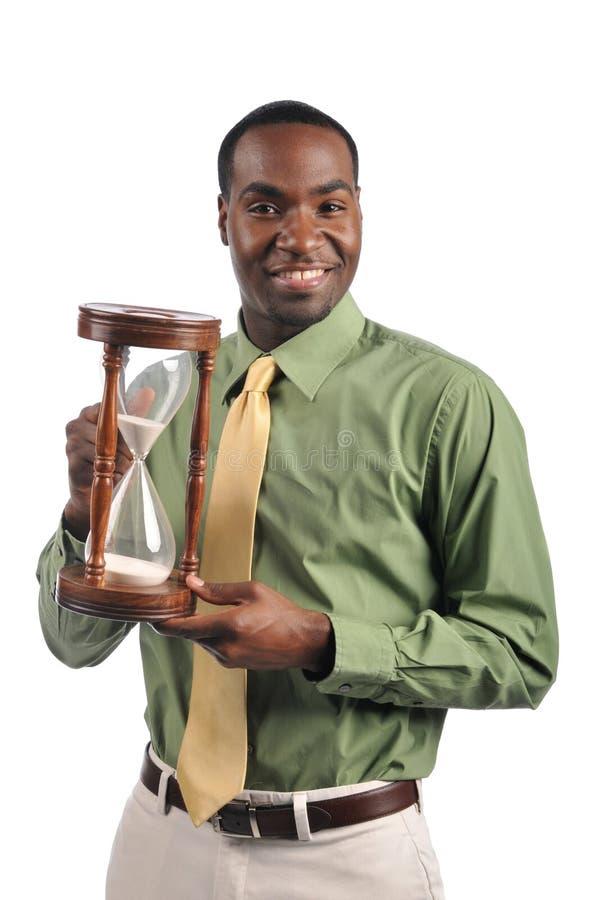 Download Businessman Holding A Sand Timer Stock Photo - Image of enterprise, investor: 11865264