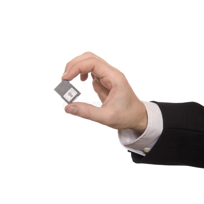 Businessman holding a Secure Digital Memory Card royalty free stock photography