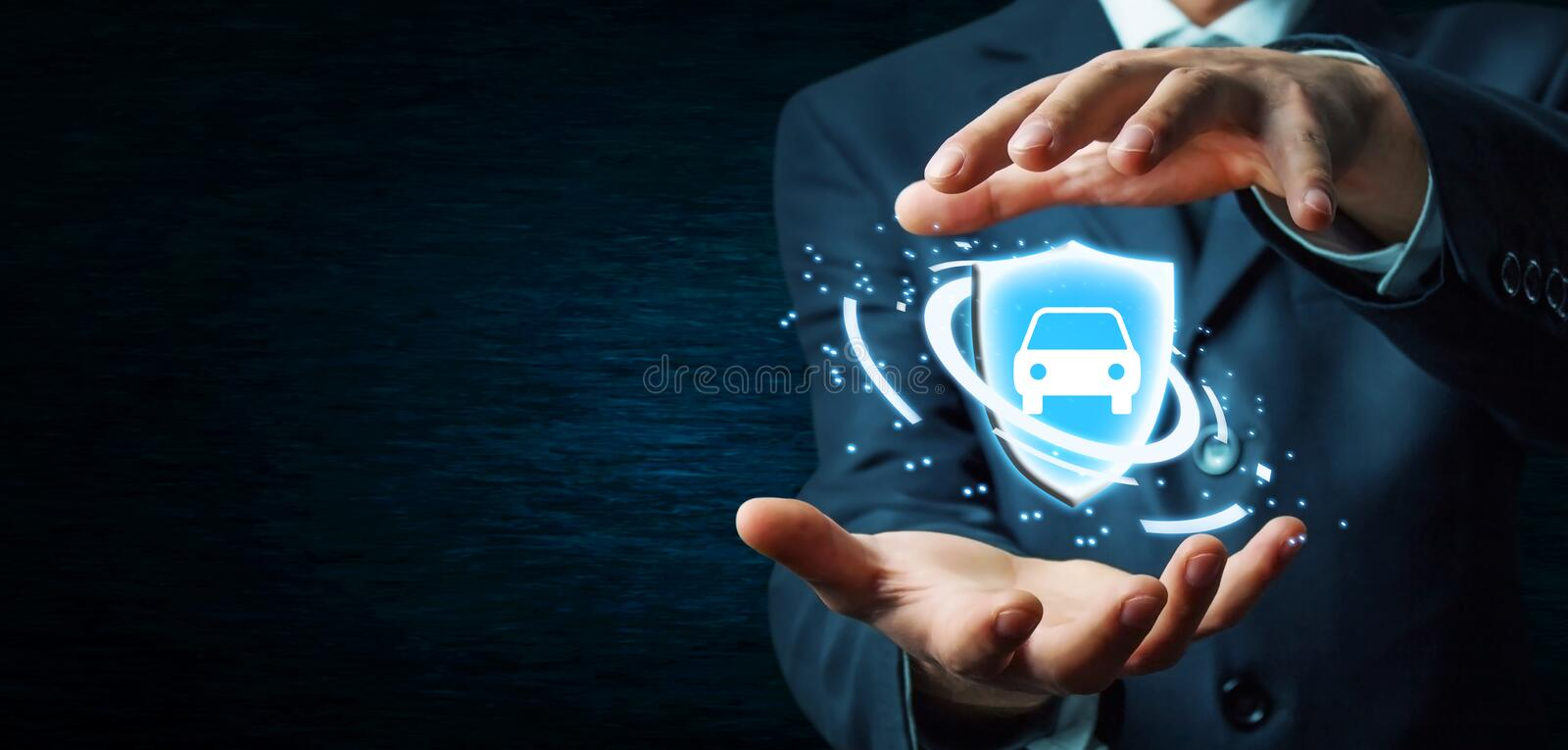 Businessman holding shield and car. Car insurance concept. stock photography