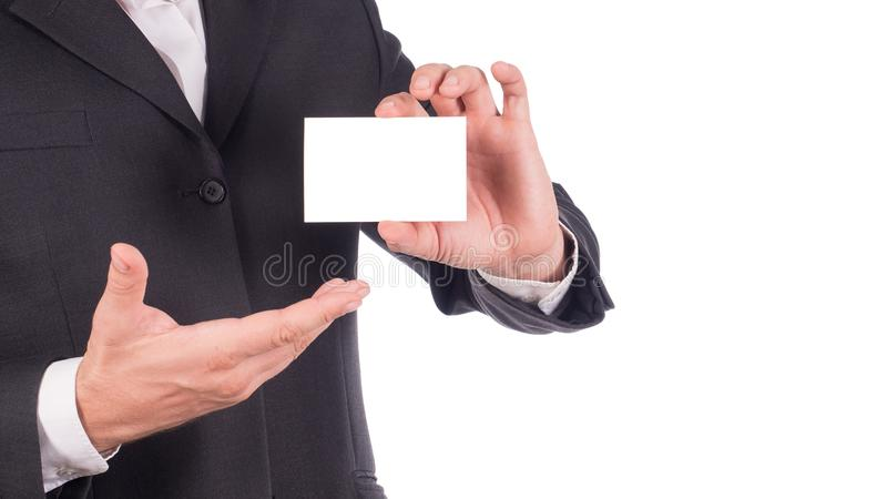 Businessman holding and showing empty business card or name card - business concept.  royalty free stock photos