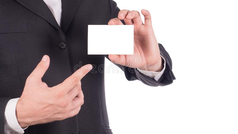 Businessman holding and showing empty business card or name card - business concept.  royalty free stock photo