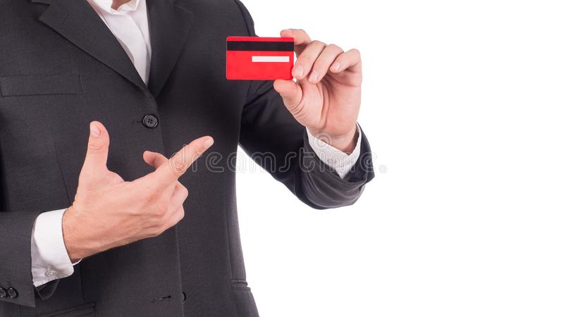 Businessman holding and showing empty credit card or name card - business concept.  royalty free stock images