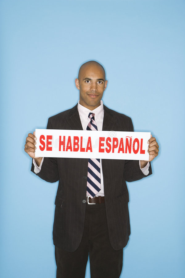 Businessman holding sign. royalty free stock photo