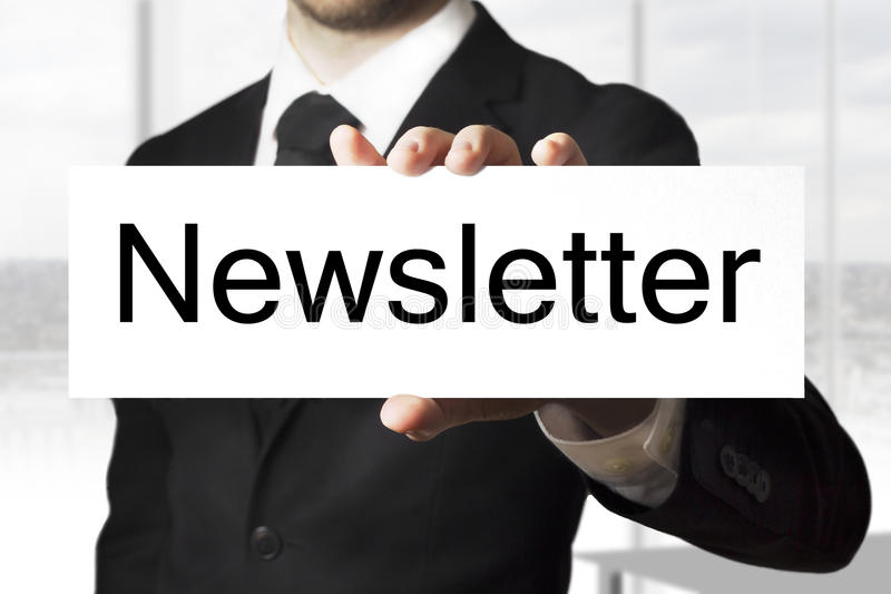 Businessman holding sign newsletter royalty free stock photo