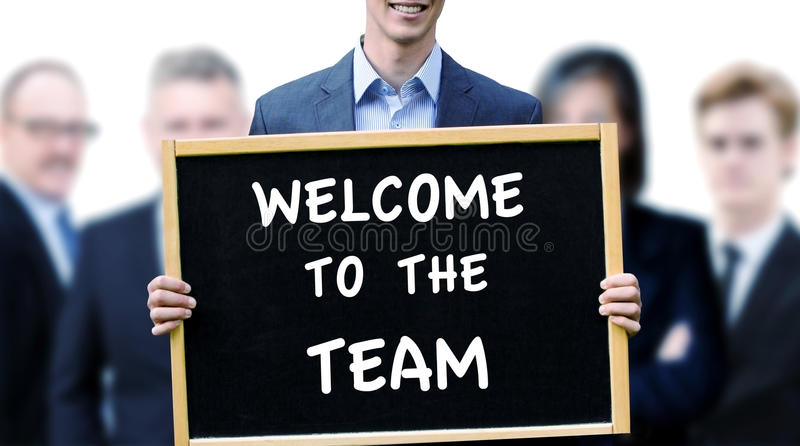 Businessman holding sign with words Welcome To The Team stock images