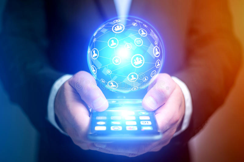 Businessman holding smartphone with network globe sphere hologra. View of a Businessman holding smartphone with network globe sphere hologram going out stock images
