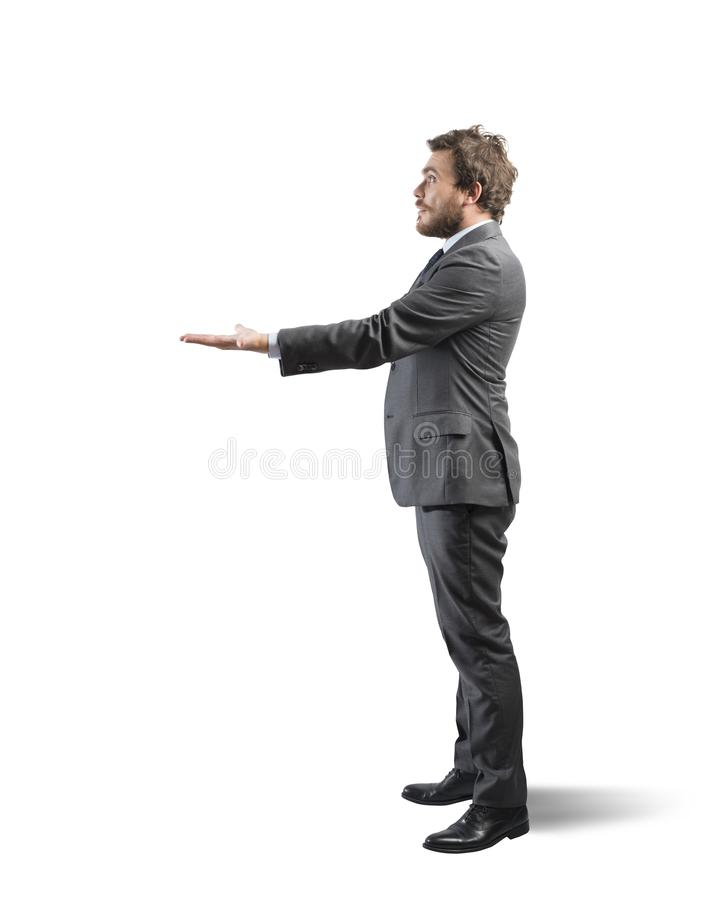 Businessman holding something in hand royalty free stock photography