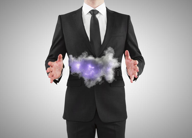 Businessman holding storm stock images