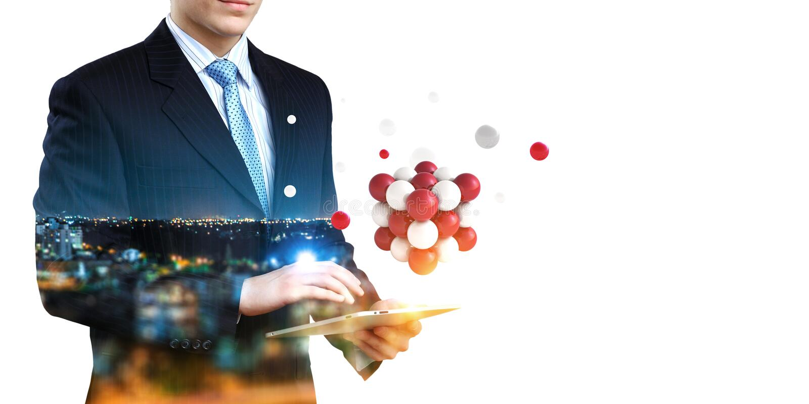 Businessman holding a tabalet with a bunch of spheres levitating above. Mixed media stock photo