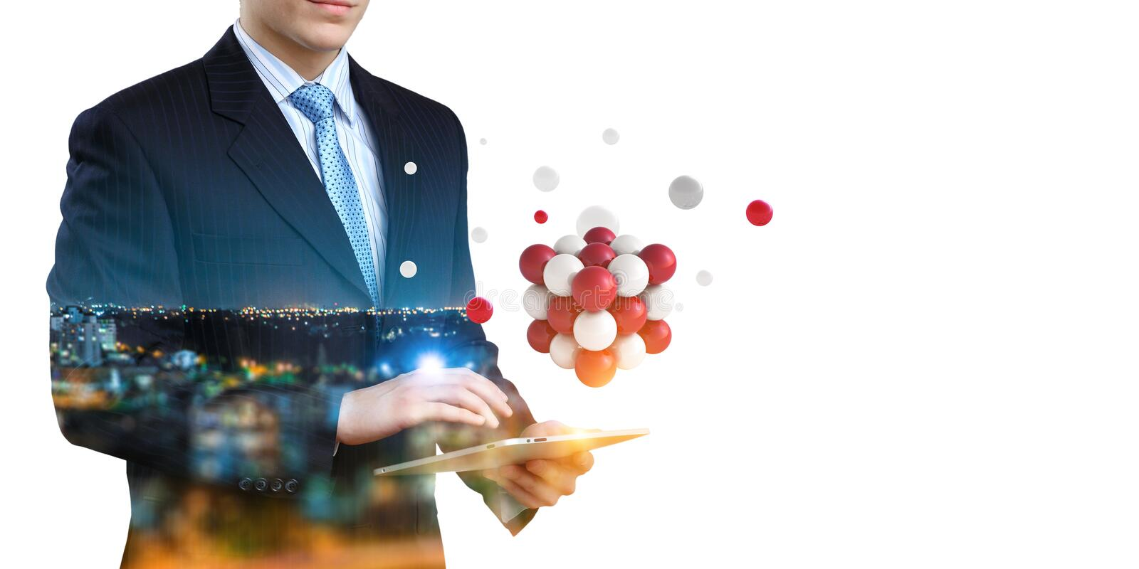 Businessman holding a tabalet with a bunch of spheres levitating above. Mixed media stock photography