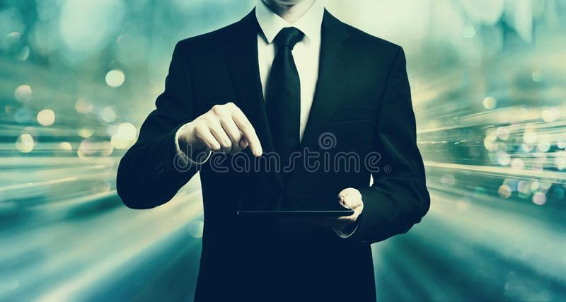 Businessman holding a tablet computer stock image