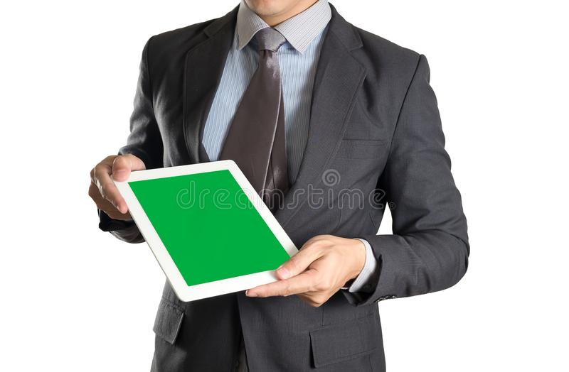 Businessman holding tablet with green screen on white isolated b royalty free stock image