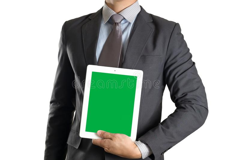 Businessman holding tablet with green screen on white isolated b royalty free stock images