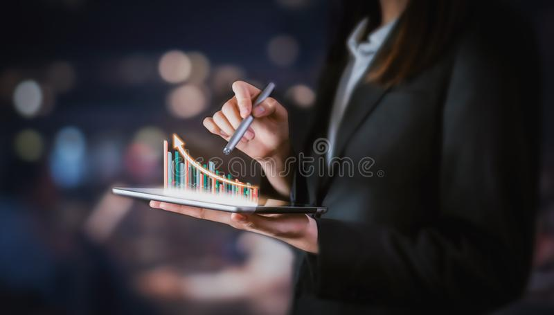 Businessman holding tablet and have a chart showing business growth. royalty free stock photo