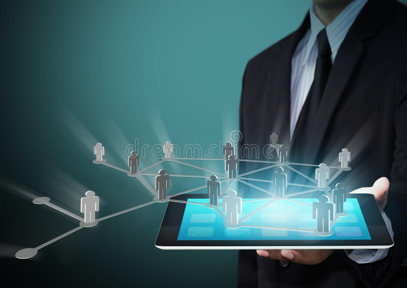 Businessman holding tablet with networking concept royalty free stock image
