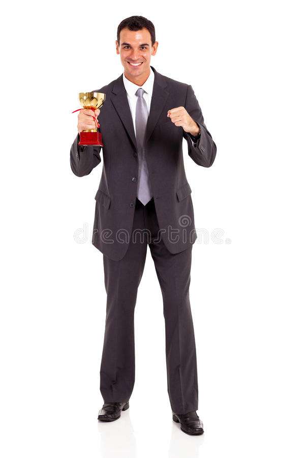 Businessman holding trophy royalty free stock photos
