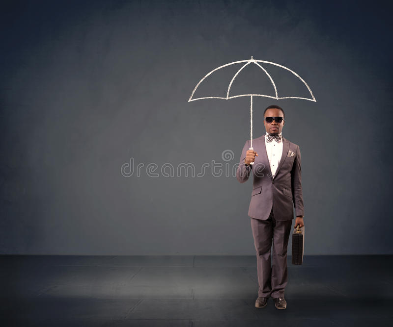 Businessman holding an umbrella. stock photos
